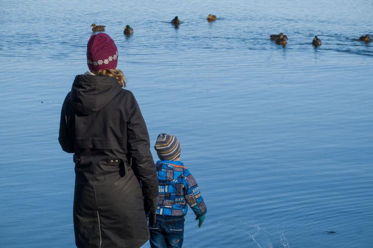 Rear view of men in lake