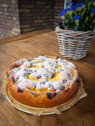 Homemade apricot blueberry cake topped with icing sugar with blue gentian flowers on a wooden table Food And Drink Food Freshness Sweet Food Still Life Table Wood - Material Indoors  No People Dessert Baked Sweet Fruit Close-up Ready-to-eat Plant Temptation Flowering Plant Flower Cake Blueberry Apricot Homemade Gentian Sugar