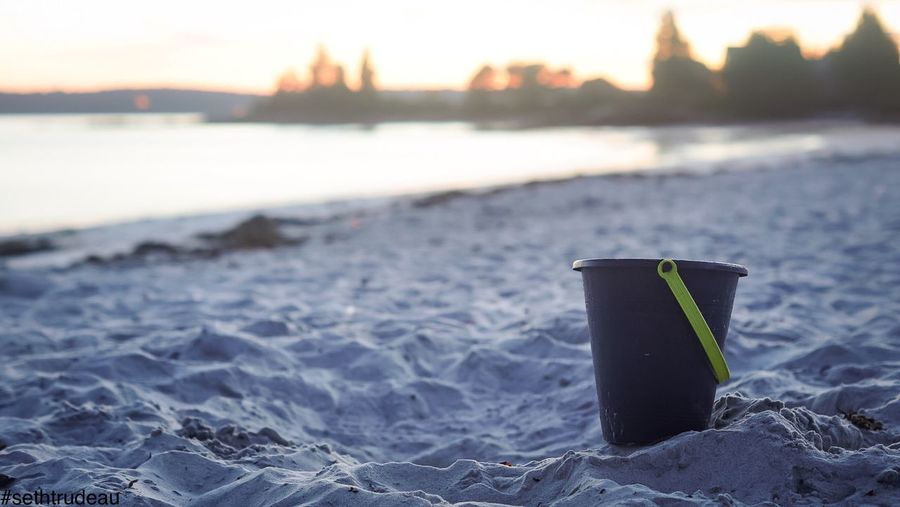 Lonely and Pail Water Focus On Foreground Beach Tranquil Scene Tranquility Sand Pole Sea Shore Nature Outdoors Scenics Ocean Solitude Sky Beauty In Nature No People Commercial Dock Vacations Sethtrudeau Photography Pale Bucket Beach Life Ocean