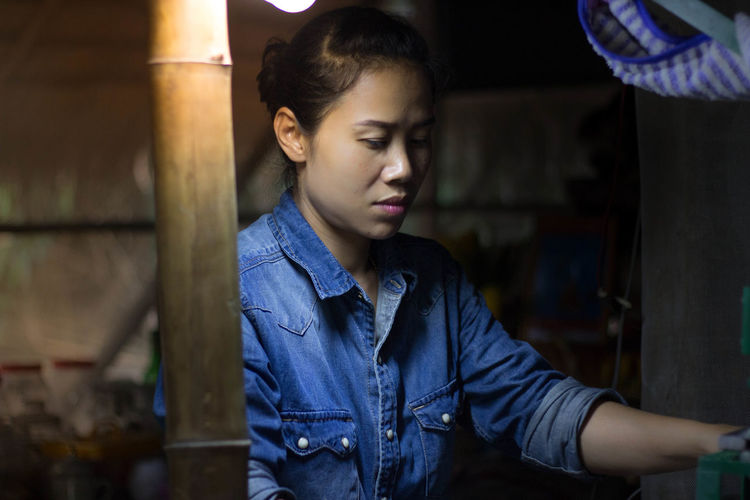 Asian girls doing some work Adult Casual Clothing Childhood Close-up Day Denim Jacket Focus On Foreground Illuminated Indoors  One Person People Real People Standing Young Adult
