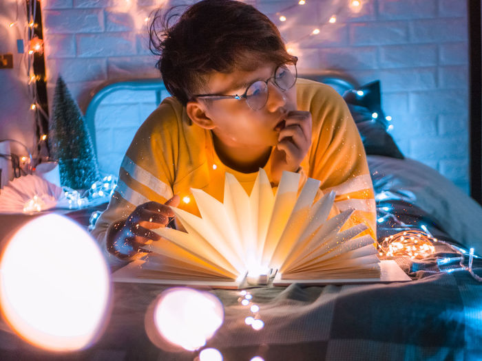 in my feeling Real People Glowing One Person Burning Fire Glasses Men Portrait Night Teenager Indoors  Illuminated Candle Fire - Natural Phenomenon Fairy Lights Light Bedroom Thinking Dream Feline Lifestyles Sitting