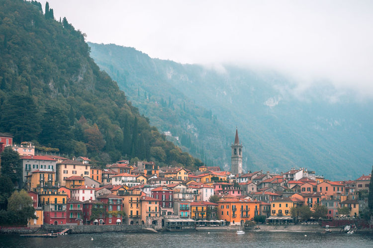 The little town of varenna sitting on the edge of lake como, italy.
