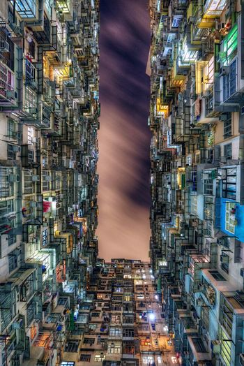 Directly below shot of montane mansiona against sky at quarry bay in city during night