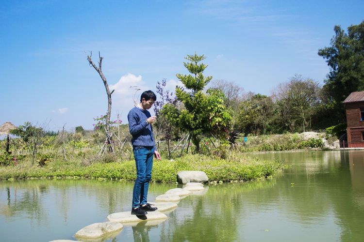 Casual Clothing Dressing Slim Scene Blue Sky Water Full Length Standing Childhood Boys Males  Flood Reflection Environmentalist