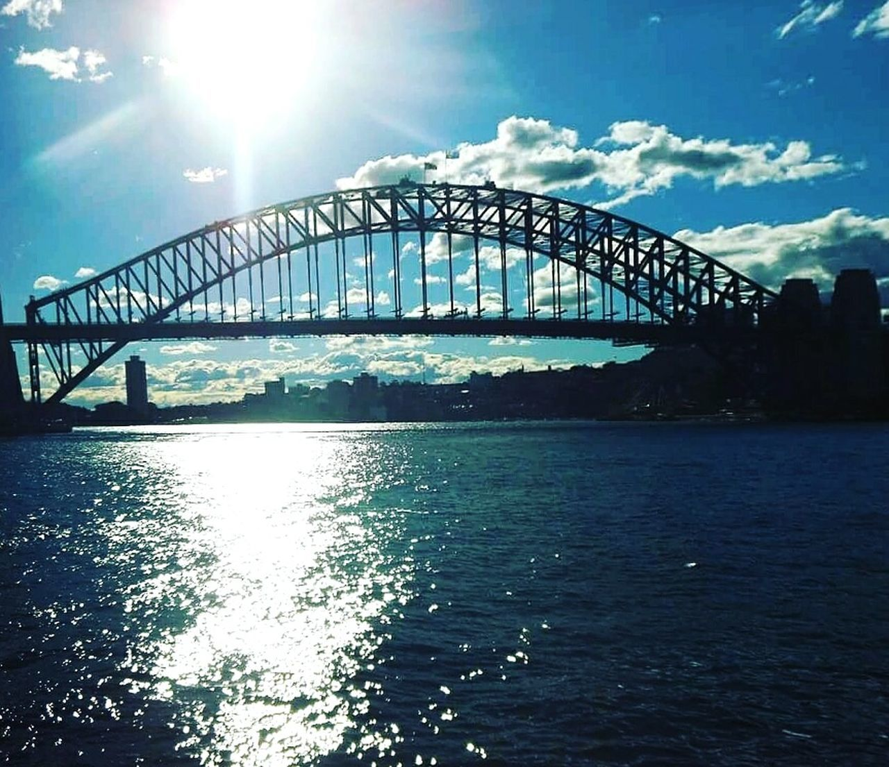 bridge - man made structure, connection, built structure, sunlight, architecture, travel destinations, no people, transportation, water, day, outdoors, sky, sea, nature, city