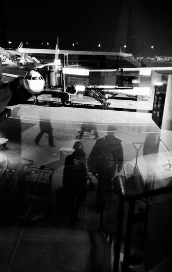 Boarding Boarding Time The Air Was Full Of Ghosts Projections Paramontage Lerone-frames Nightphotography Peoplephotography Airport In The Terminal Adventures Beyond The Ultraworld Shillouette Backing People People Photography