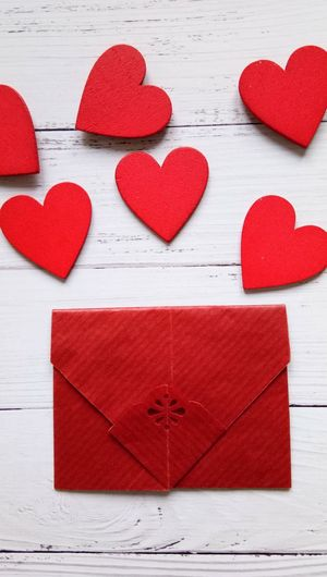 Red Heart Shape And Envelope On Table