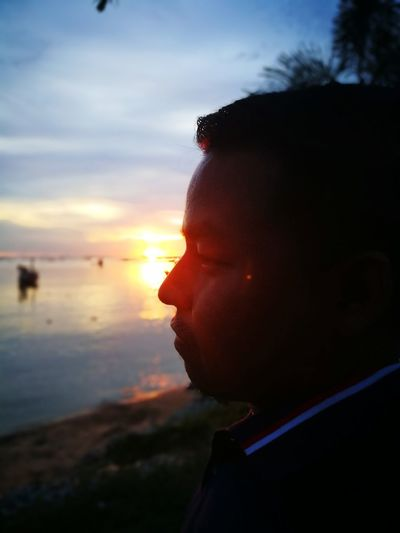One Person Sunset People Human Face Portrait Beach Outdoors The Portraitist - 2017 EyeEm Awards EyeEmNewHere