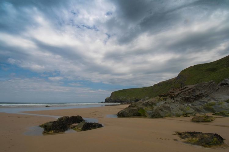 Rocks and Sky Dramatic Sky Watergate Bay Beach Beauty In Nature Cloud - Sky Cornwall Horizon Horizon Over Water Land Nature No People Non-urban Scene Rock Rock - Object Rocky Coastline Sand Scenics - Nature Sea Sky Solid Tranquil Scene Tranquility Water
