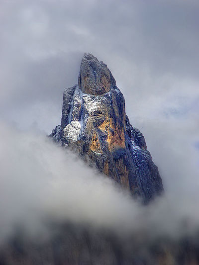 Low angle view of rock against sky
