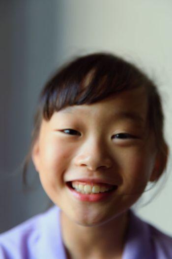 Close-up portrait of a smiling boy