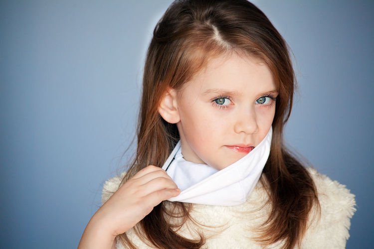 Portrait of cute girl against white background