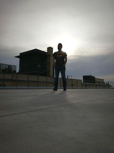 Man standing on street against sky