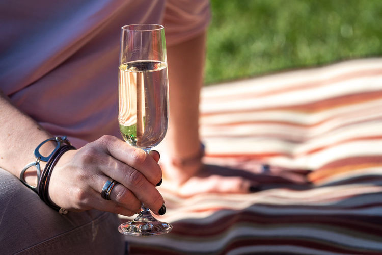 Woman Adult Alcohol Drink Drinking Finger Focus On Foreground Food And Drink Glass Hand Holding Human Body Part Human Hand Leisure Activity Lifestyles Midsection People Real People Refreshment Wine Women