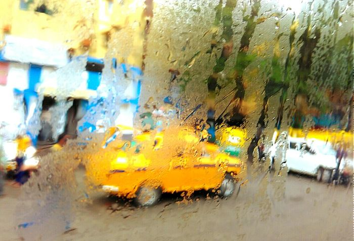 Kolkata Rainfall The Essence Of Summer Summer Summer2016 Kolkatacity Taxi Cab Focus On Background Focus Object Focused Thoughts Focus Outdoor Photography Street Photography
