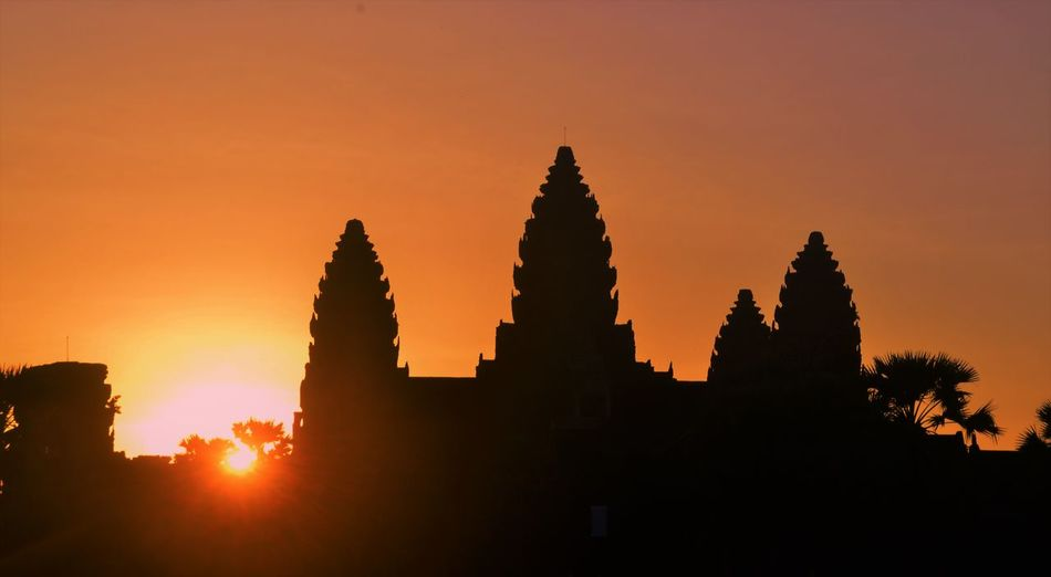 Silhouette Angkor Wat Temple Against Orange Sky
