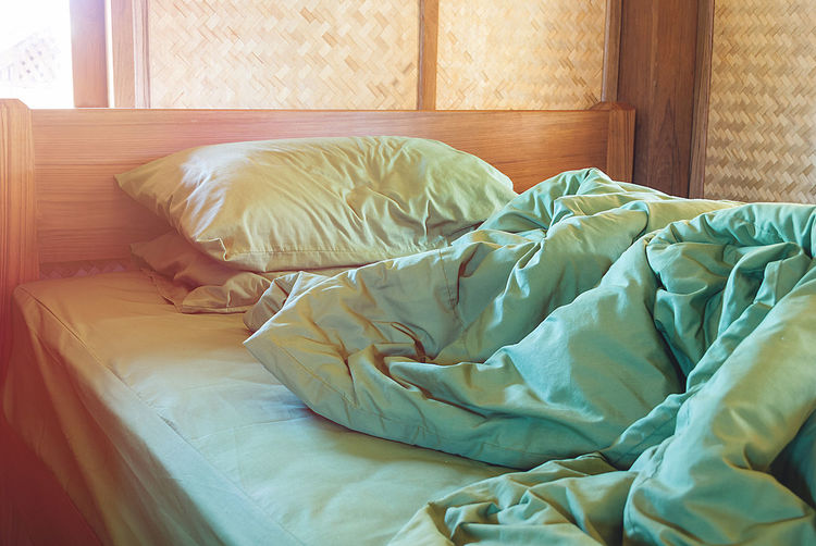Crumpled Duvet On Bed At Home