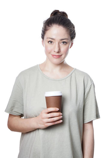 Looking At Camera One Person Front View White Background Studio Shot Indoors  Casual Clothing Drink Smiling Young Adult Holding Standing Cut Out Lifestyles Food And Drink Waist Up Young Women Drinking Beautiful Woman Isolated Coffee Cup Disposable Coffee To Go Latte To Go