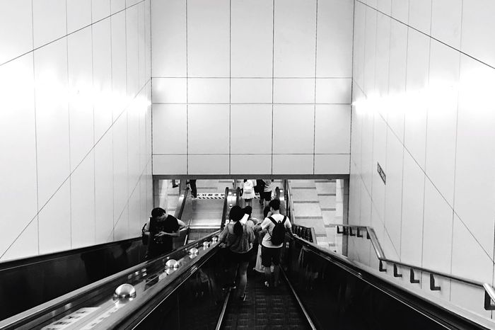 Real People Lifestyles Men Indoors  Transportation Women Leisure Activity Built Structure Architecture Metro Metro Station Black And White Symmetry China Chinese Standing Day Technology Illuminated Friendship Adult People