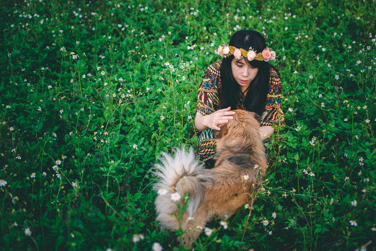 Young woman with dog on field