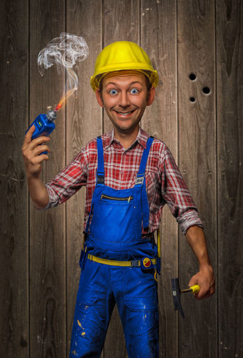 Funny Craftsman Builder Comic Cordless Screwdriver Craftsman Drill Expert Foreman Funny Hammer Helmet Joy Lumberjack Shirt One Person Pencil People Portrait Shirt Smoke - Physical Structure Tool Witty Wood - Material Work Work Pants Worker Yellow