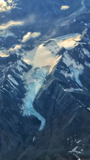 Ice Age Oh Mother Nature Changes In Glaciers Receding Scenics Mountain Tranquil Scene Aerial View Beauty In Nature Tranquility High Angle View Landscape Mountain Range Non-urban Scene Nature Winter Cold Temperature Idyllic Physical Geography Geology Water River Majestic Mountain Peak Birds Eye View Flying High