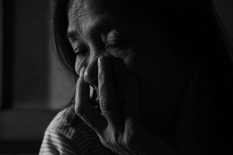 Close-up of depressed senior woman