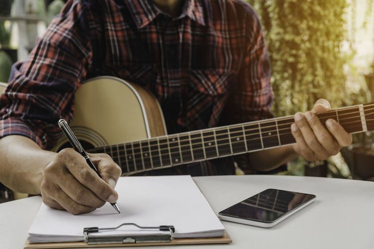 Man playing guitar on table