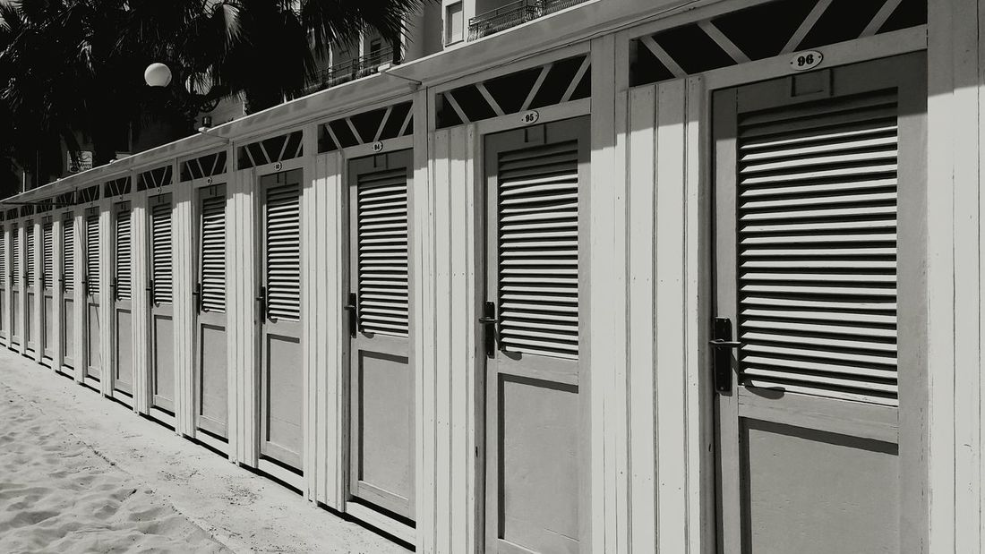 Architecture In A Row Outdoors Built Structure Repetition Beach Doors Building Exterior Changing Rooms Eyem Gallery
