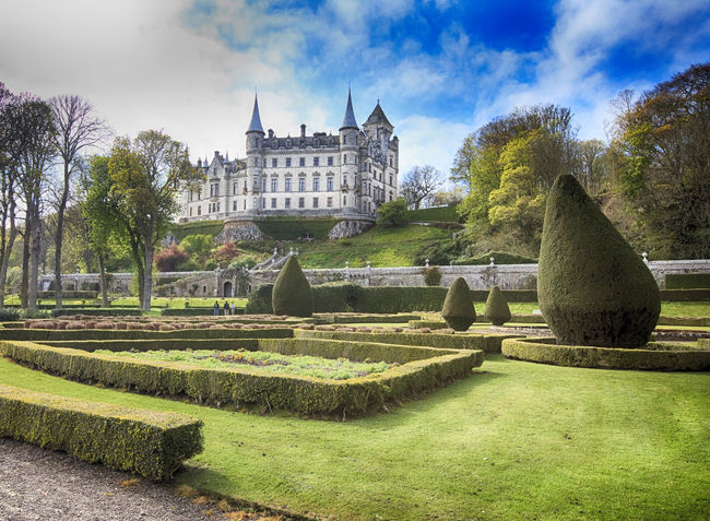 Dunrobin Castle is a stately home in Sutherland, in the Highland area of Scotland, and the family seat of the Earl of Sutherland and the Clan Sutherland Architecture Building Exterior Built Structure City Day Dunrobin Castle Formal Garden Grass Historical Building Landscape Landscape_photography Nature No People Ornamental Garden Outdoors Panorama Park - Man Made Space Scotland Scottish Castle Scottish Highlands Sky Sutherland Travel Destinations Tree