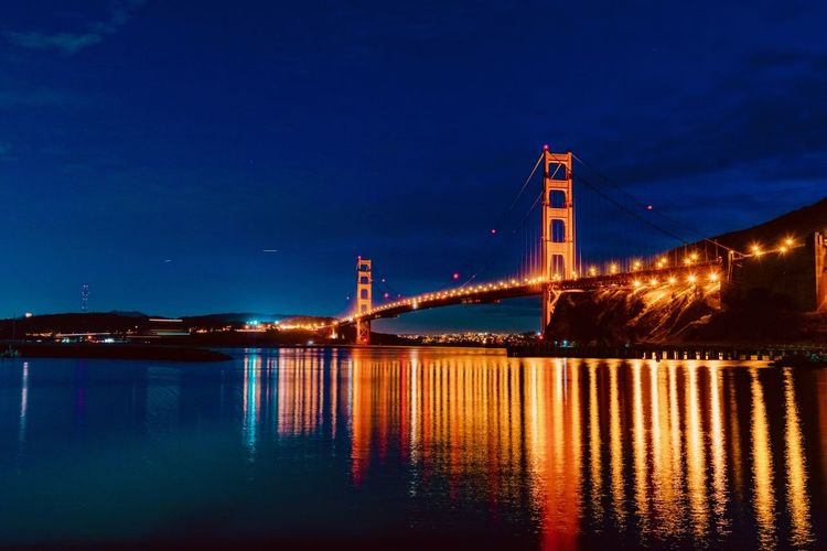 Illuminated Water Bridge Built Structure Architecture Bridge - Man Made Structure Sky Reflection Night Connection Transportation Suspension Bridge Nature No People Waterfront Blue River City Building Exterior Outdoors Bay