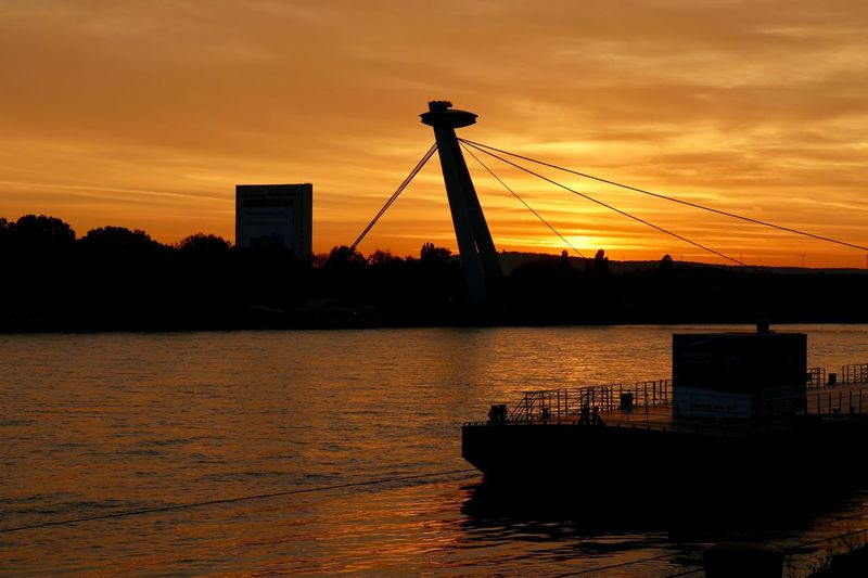 Sunset over the Danube Water Sky Sunset Nautical Vessel Silhouette Transportation Nature Orange Color Waterfront Machinery Mode Of Transportation Architecture No People Cloud - Sky Reflection Built Structure Beauty In Nature