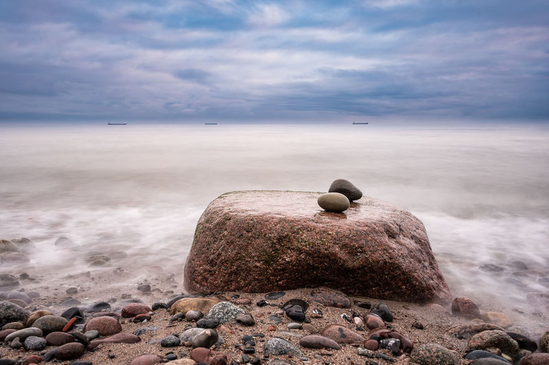 Stones on shore of the Baltic Sea. Baltic Sea Beach Beauty In Nature Boulders Cloud - Sky Coast Day Horizon Over Water Landscape Nature No People Outdoors Pebble Pebble Beach Rock - Object Rocks Scenics Sea Shore Sky Stones Tourism Travel Destinations Water
