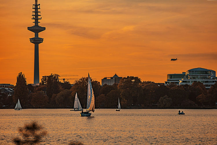 Sky Sunset Built Structure Architecture Orange Color Water Nature Waterfront City Cloud - Sky Transportation Outdoors Hamburg, Hamburg Germany Alster Alster View Beluga, Transportflugzeug,