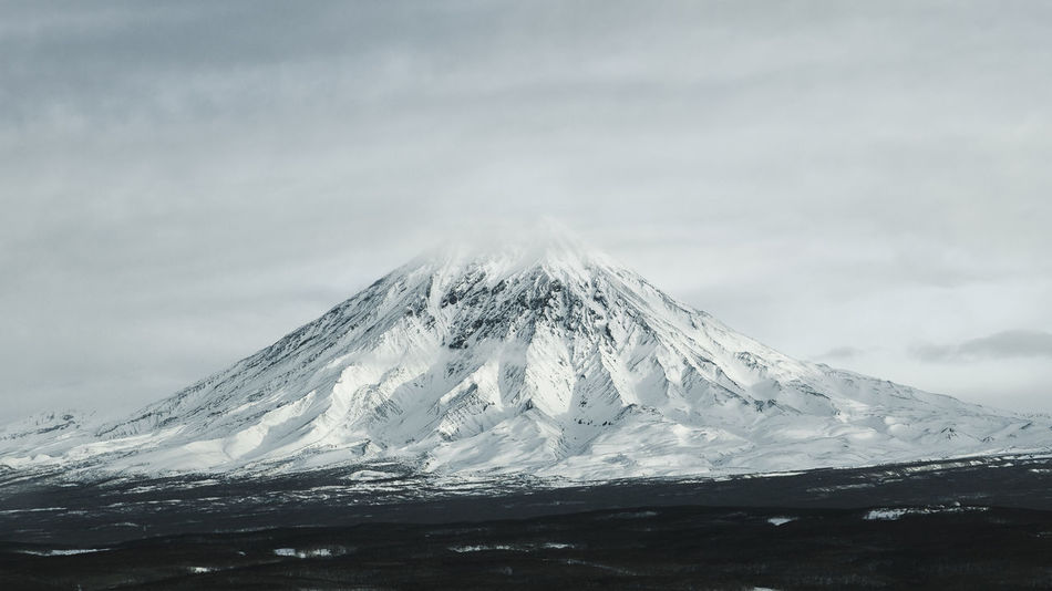 EyeEm Ready   Volcano Volcanic Landscape Tranquility Tranquil Scene Snowcapped Mountain Snow Sky Scenics Power In Nature Outdoors No People Nature Mountain Landscape Kamchatka Day Cold Temperature Cloud - Sky Beauty In Nature Winter Travel Photography Travel Snow ❄ Kamchatka Krai