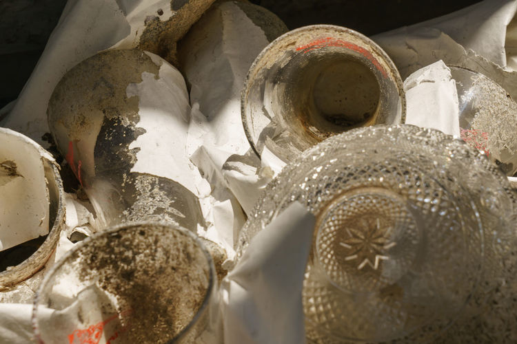 High angle view of shells in container on table