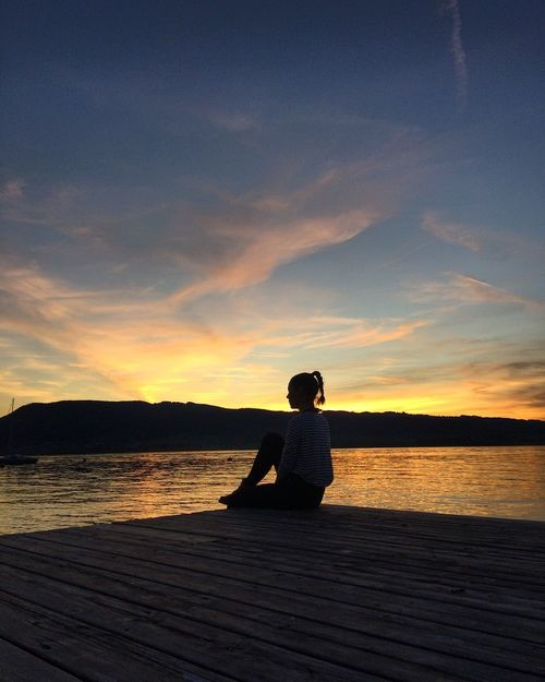 Sunset Attersee Water Tranquil Scene Scenics Beauty In Nature Nature Lake Jetty Cloud - Sky Sitting One Person Sky Lifestyles Relaxation Tranquility Women Full Length Real People Outdoors Only Women