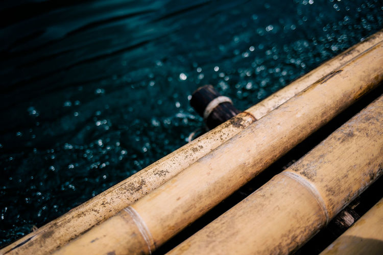 Close-up of wooden raft in lake
