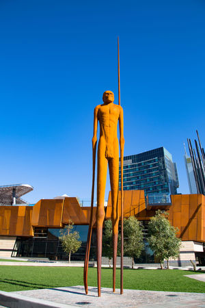 Aboriginal Architecture Art And Craft Blue Building Exterior Built Structure Clear Sky Copy Space Day Full Length Human Representation Low Angle View Male Likeness Men Nature One Person Outdoors Representation Sculpture Sky Sunlight