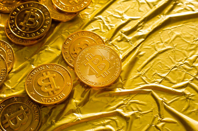 The Bitcoin cryptocurrency in gold texture image background. Currency Backgrounds Bitcoin Bitcoin Cash Bitcoin Coin Bitcoin Currency Bitcoin Wallet Bitcoins Cryptocurrency Currency Currency Symbol Finance Gold Gold Colored Indoors  Ingot Large Group Of Objects Luxury Metal No People Paper Shiny Silver Colored Success Wealth