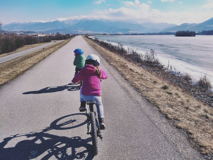 Pink Color Hoodie Springtime Spring Sunny Day Sports Kids Sports Brother & Sister Headwear Bicycle Shadow People Cycling Childhood Full Length Rear View Riding Outdoors Children Only Leisure Activity