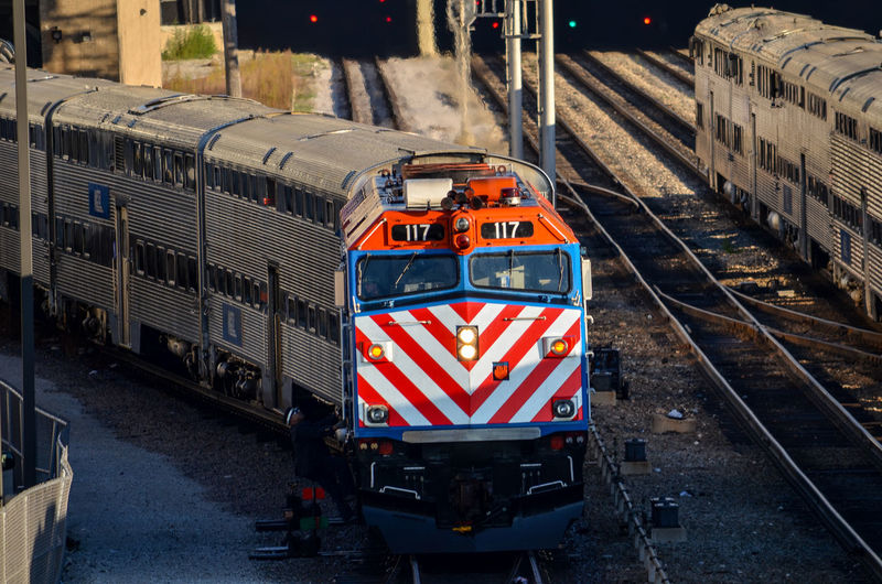 Commuter train in Chicago leaving the station. Chicago City Commuter Train Metra Train No People Outdoors Railroad Tracks Red Red-white Stripes Train Transportation