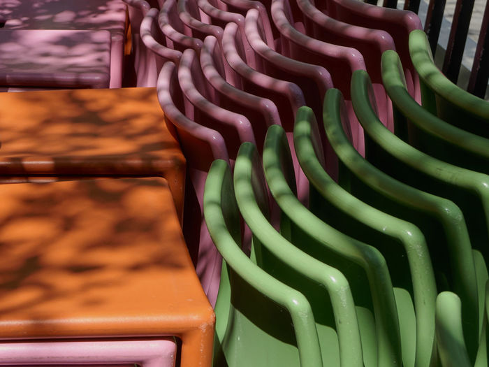 outdoor patio chairs Abundance Close-up Colorful Day Large Group Of Objects No People Outdoors Repetition Retail  Stacked Chairs