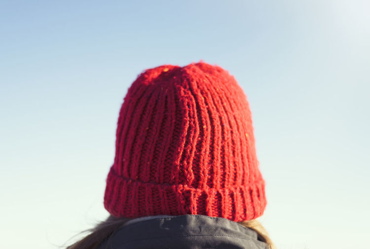 Red Red Hat Sunlight Winter Wintertime Beanie Blue Blue Sky Clear Sky Close-up Copy Space Female Gloves Looking Lookingatthesky Lookingaway Mittens One Person Sky Sunglasses