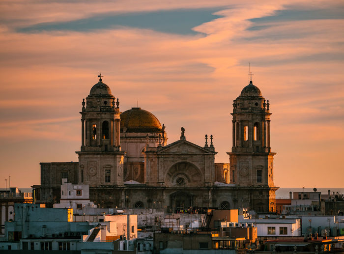 Rooftops and cathedral of Cádiz during sunset Andalucía Architecture Belief Building Building Exterior Built Structure Catholicism City Cloud - Sky Dome Nature No People Occident Orange Color Outdoors Place Of Worship Religion Rooftops Sky Spire  Spirituality Sunset The Past Travel Travel Destinations