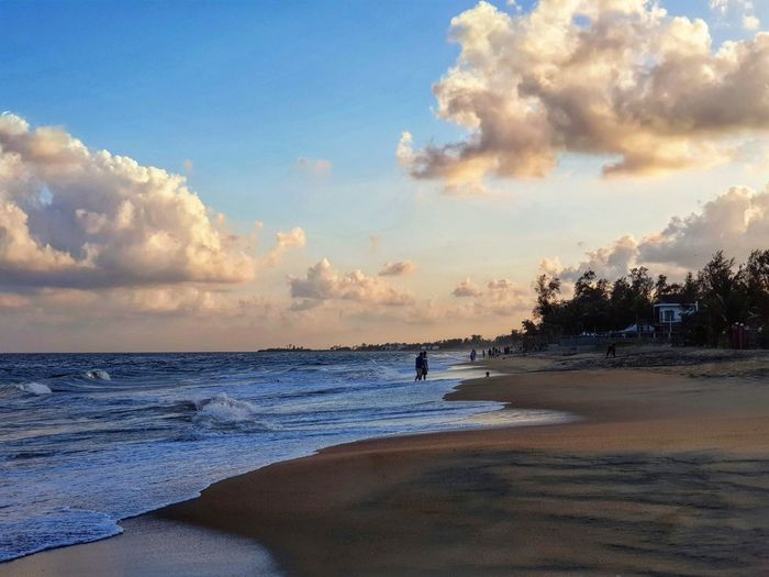 A solitary beach at Mamalapuram in Tamil Nadu Beach Sea Water Cloud - Sky Tranquility Nature Sand Sky Sunset Vacations Scenics Travel Destinations Beauty In Nature Outdoors Horizon Over Water Tranquil Scene Travel