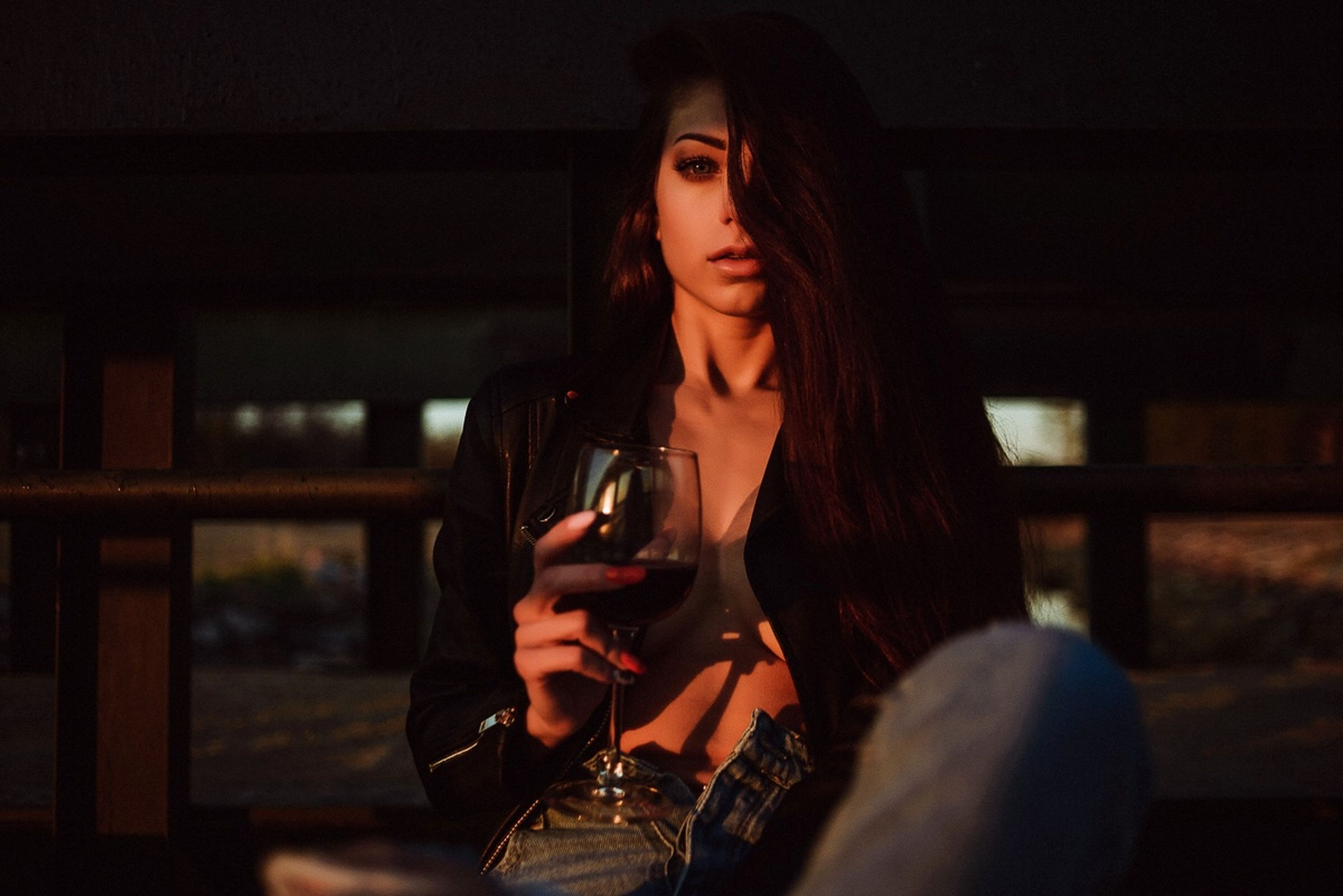 one person, young adult, drink, alcohol, indoors, real people, lifestyles, young women, wine, holding, leisure activity, refreshment, food and drink, casual clothing, long hair, looking, front view, portrait, hairstyle, glass, beautiful woman, happy hour, drinking, contemplation