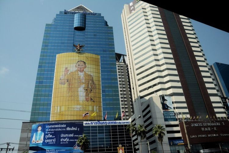 Thailand's King Bhumibol Adulyadej - the world's longest-serving monarch - has died aged 88. His death is expected to throw the politically turbulent Country into uncertainty. Architecture Building Exterior Skyscraper Built Structure Low Angle View Tall - High City Modern Tower Office Building Building Story Tall Glass - Material Urban Skyline Development Travel Destinations City Life Financial District  Downtown District Sky Bhumibol King Of Thailand Thailand King Bhumibol Abdulayeh