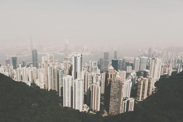 Skyscrapers seen through victoria peak against clear sky