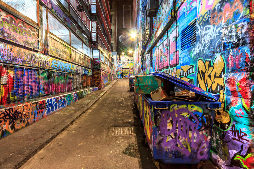 A laneway filled with graffiti Absence Alley Architecture Art And Craft Building Built Structure City Creativity Diminishing Perspective Direction Environmental Issues Footpath Graffiti Illuminated Indoors  Multi Colored Mural No People Pollution Street Art The Way Forward Wall - Building Feature